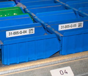 ONE2ID magazijnlabels Kardex kast opslagsysteem barcode etiketten