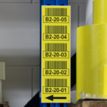 ONE2ID warehouse signs pallet racking uprights aisles
